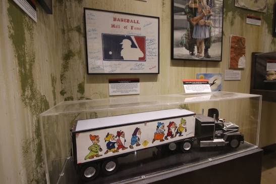 The model truck at the bottom was built by a prison mate of Gacy's, and Gacy painted the Seven Dwarves on the side.