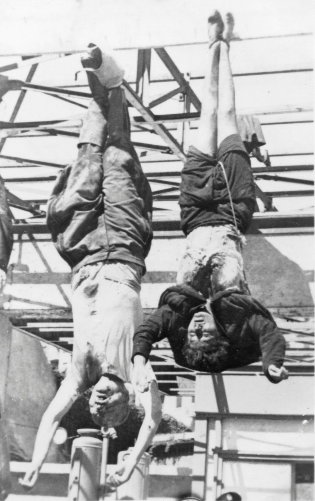 The bodies of Benito Mussolini and Clara Petacci hanging at the Esso gas station in Piazzale Loreto in Milan, Italy